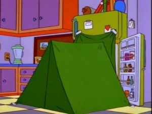 A refrigerator with its door open, and a green tent set up in front of the open door.